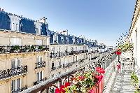 a stylish balcony with wonderful views of the Parisian building in a 2-bedroom paris luxury apartmen