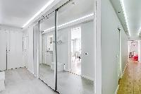 hallway with mirrors  in a 2-bedroom paris luxury apartment