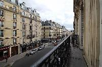 street view from the balcony in a 3-bedroom Paris luxury apartment