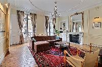 elegant living area with ornate and high ceilings in its neutral motif of a Paris luxury apartment