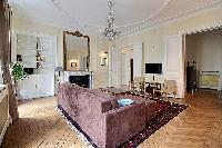 3-bedroom Paris luxury apartment tastefully decorated interiors with its original wooden floors