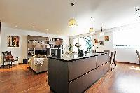 chic living area, kitchen, and dining area in a 2-bedroom paris luxury apartment