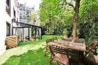 extravagant 2-bedroom paris luxury apartment boasts a beautiful and well-maintained backyard