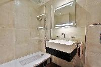 shower area and sink in paris luxury apartment