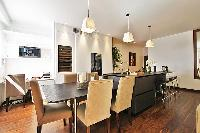 the dining area with a 5-seater dining set in a 2-bedroom paris luxury apartment