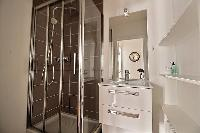 bathroom with sink and shower in Paris luxury apartment