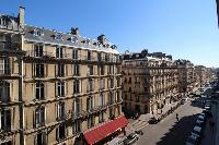view from a lovely balcony in Paris luxury apartment overlooks the street