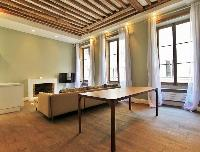 2-bedroom Paris luxury apartment with its original exposed ceiling beams and wooden floors