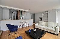 a large and open kitchen and living in a 3-bedroom Paris luxury apartment