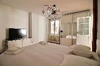 comfortable bedroom with a Queen size bed in a 3-bedroom Paris luxury apartment