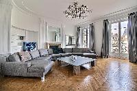elegant living room and balcony of Trocadero - Georges Mandel luxury apartment