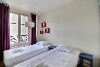 fresh and clean bed sheets and pillows in Ternes - Wagram luxury apartment
