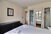 neat and nice bedroom linens in Ternes - Wagram luxury apartment