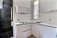 fully equipped semi-separated kitchen in a 2-bedroom Paris luxury apartment