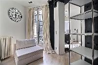 spacious living room in a 2-bedroom Paris luxury apartment