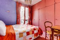 bright-colored bedroom of Mouffetard - Carmes luxury apartment