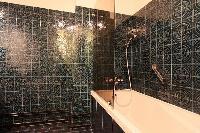 elegant bathroom with bathtub in a 3-bedroom Paris luxury apartment