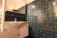 bathroom with sink  in a 3-bedroom Paris luxury apartment
