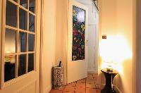 entrance with colorfully designed door in a 3-bedroom Paris luxury apartment