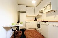 separated kitchen in a 3-bedroom Paris luxury apartment