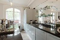 charming 3-bedroom Paris luxury apartment with a large living and dining area with an open kitchen
