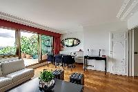 awesome living room with balcony at Trocadero - Poincaré 2 bedrooms luxury apartment