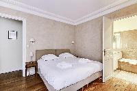 Master Bedroom with a Queen size bed, plenty of closet space, and an en-suite bathroom composed of a