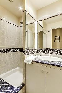 second bathroom with a shower and a sink in a 2-bedroom Paris luxury apartment