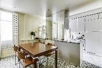a grand fully-equipped kitchen that is large for Parisian standards in a 2-bedroom Paris luxury apar