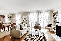 beautifully decorated open living area in a 2-bedroom Paris luxury apartment