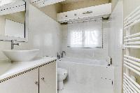 pristine toilet and bath in Louvre Palais Royal IV luxury apartment