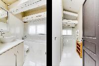 clean and neat bathroom with tub in Louvre Palais Royal IV luxury apartment