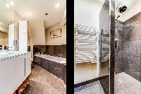 fresh and neat bathroom with tub in Louvre Palais Royal IV luxury apartment