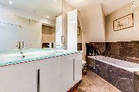 neat and fresh bathroom with tub in Louvre Palais Royal IV luxury apartment