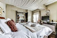 perky and pleasant bedroom of Louvre Palais Royal IV luxury apartment