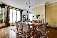 dining room for eight with a long table and chandelier in paris luxury apartment