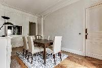 elegant dining table can seat up to six guests  in a 2-bedroom Paris luxury apartment