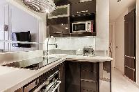 modern well-equipped Kitchen in a 2-bedroom Paris luxury apartment