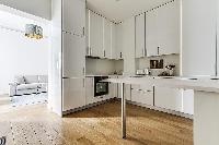 clean and white Kitchen in a 1-bedroom Paris flat