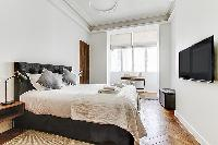 Bedroom with Queen size bed, bedside tables, a TV lamps, and plenty of closets in a 2-bedroom Paris
