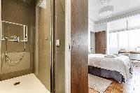 master bedroom and master bathroom with standing shower in Paris luxury apartment