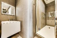 master bathroom with standing shower in Paris luxury apartment