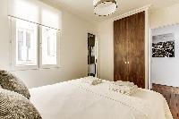 Bedroom with Queen size bed in a 2-bedroom Paris luxury apartment
