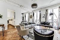Living room with Haussman ornate ceilings, long French windows, original wooden floors and decorativ