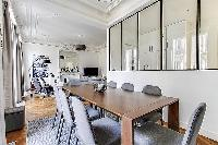 open dining room with a beautiful antique table that can seat up to eight guests  in a 2-bedroom Par