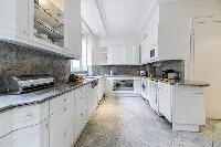 fully equipped modern kitchen in a 3-bedroom Paris luxury apartment