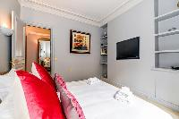 third bedroom with comfortable sleeping amenities and plenty of closets in a 3-bedroom Paris luxury