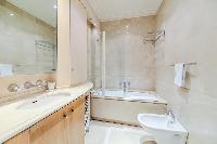 full bathroom with a toilet in a 3-bedroom Paris luxury apartment