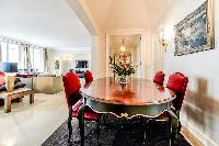 stylish dining table and 4 seats in a 3-bedroom Paris luxury apartment