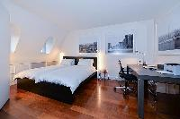 lovely bedroom with 2 single beds, study table, and parquet floor elegantly designed 2-bedroom paris